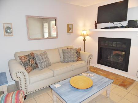 Click to enlarge image Living room with large flat screen tv - BeeGee's Redfish Quarters - Large 2 bedroom, 2.5 bath with tile and laminate floors, private laundry, Dog Friendly. Walk to the beach. Covered Patio.