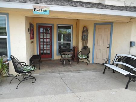 Click to enlarge image Private entrance and seating area - BeeGee's Redfish Quarters - Large 2 bedroom, 2.5 bath with tile and laminate floors, private laundry, Dog Friendly. Walk to the beach. Covered Patio.