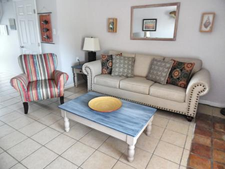 Click to enlarge image New light and bright furnishings - BeeGee's Redfish Quarters - Large 2 bedroom, 2.5 bath with tile and laminate floors, private laundry, Dog Friendly. Walk to the beach. Covered Patio.