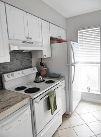 Click to enlarge image All new appliances - BeeGee's Redfish Quarters - Large 2 bedroom, 2.5 bath with tile and laminate floors, private laundry, Dog Friendly. Walk to the beach. Covered Patio.