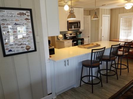 Click to enlarge image Large bar area open to living room - The Light House, Charming 2BR, Dog Friendly, Screened Porch - Private Home, Sleeps 6, Fenced Yard, Walk to shopping.