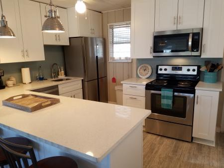 Click to enlarge image All new open kitchen - The Light House, Charming 2BR, Dog Friendly, Screened Porch - Private Home, Sleeps 6, Fenced Yard, Walk to shopping.