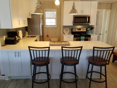 Click to enlarge image Bar seating - The Light House, Charming 2BR, Dog Friendly, Screened Porch - Private Home, Sleeps 6, Fenced Yard, Walk to shopping.