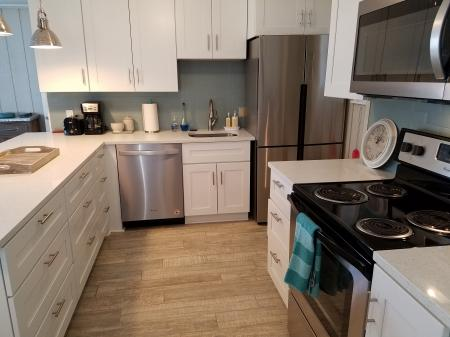 Click to enlarge image All new stainless kitchen - The Light House, Charming 2BR, Dog Friendly, Screened Porch - Private Home, Sleeps 6, Fenced Yard, Walk to shopping.