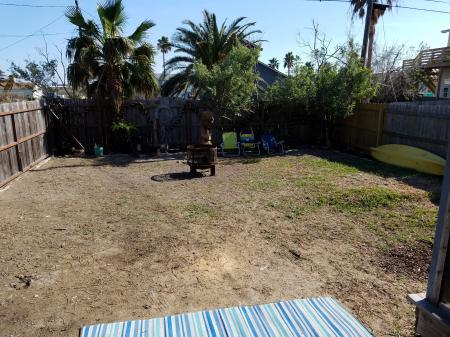 Click to enlarge image Large yard for kids and pets to run - The Light House, Charming 2BR, Dog Friendly, Screened Porch - Private Home, Sleeps 6, Fenced Yard, Walk to shopping.