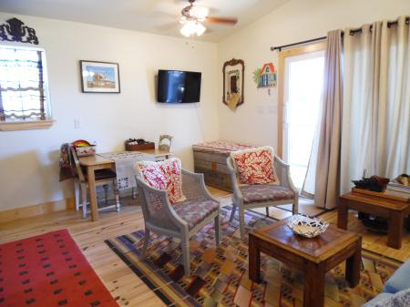 Click to enlarge image Flat screen TV in the living/dining. - Casita Jardin, 1 Bedroom, 1 Bath Upper Floor Bungalow, Sleeps 2, - No children, No Pets, Walk to Restaurants, Nightlife, and Shopping